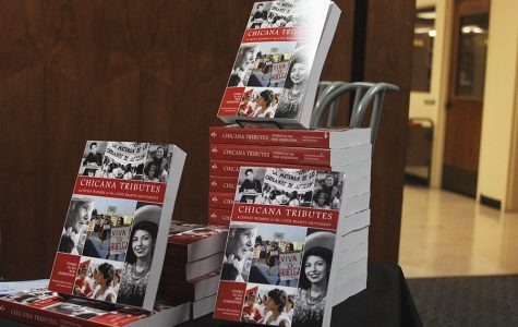 """New anthology """"Chicana Tributes: Stories for the New Generation,"""" is displayed outside of an organized panel discussion in Love Library."""