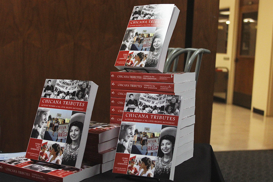 "New anthology ""Chicana Tributes: Stories for the New Generation,"" is displayed outside of an organized panel discussion in Love Library."