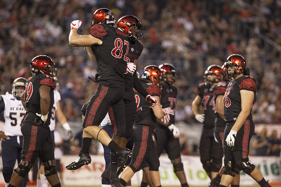 Sophomore+tight+end+Kahale+Warring+celebrates+his+touchdown+during+SDSU%27s+opening+game+win+over+UC+Davis.