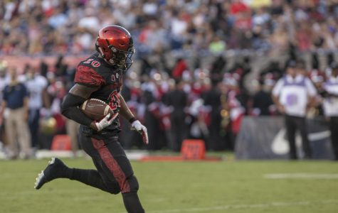 Senior running back Rashaad Penny breaks across the goal line in SDSU's win over UC Davis.