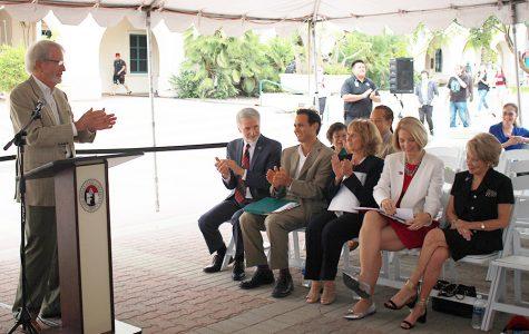 Two alumni honored with plaza dedication
