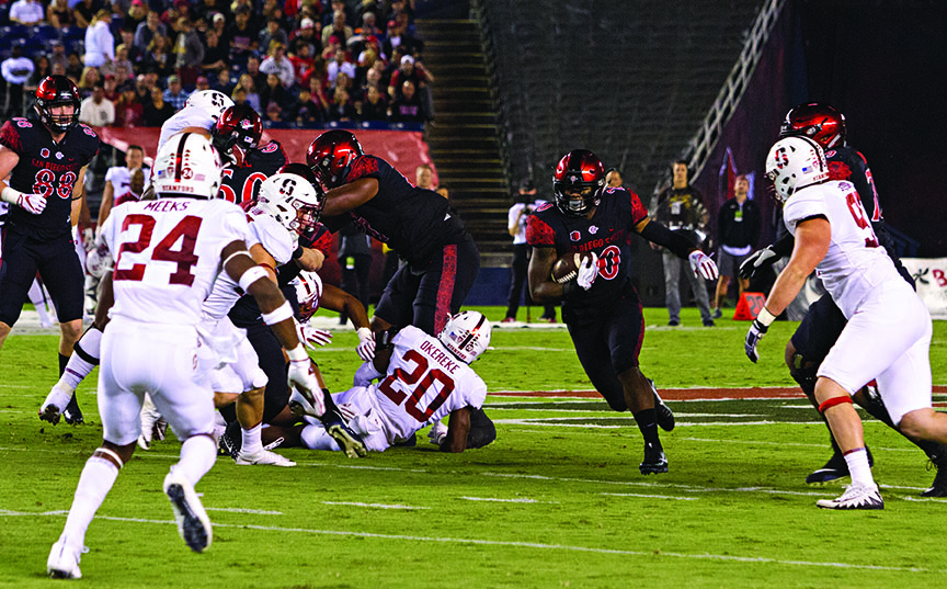 Senior running back Rashaad Penny finds a hole in the Stanford defense during SDSU's 20-17 win over the Cardinal on Sept. 16.
