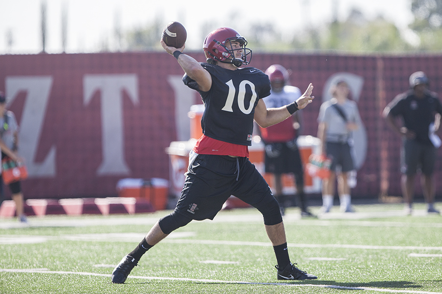 SDSU redshirt junior quarterback Christian Chapman throws a pass during a fall practice.
