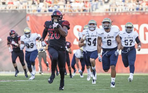 Senior running back Rashaad Penny outruns the entire UC Davis defense on his way to a touchdown.