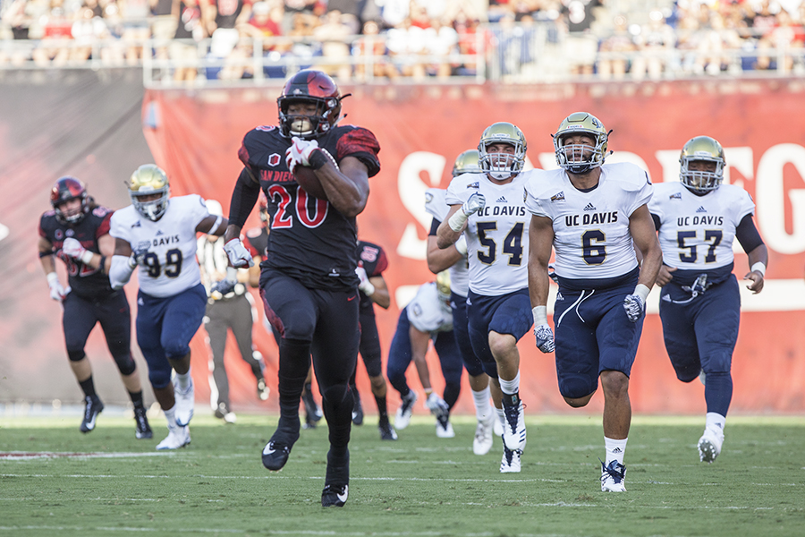 Senior+running+back+Rashaad+Penny+outruns+the+entire+UC+Davis+defense+on+his+way+to+a+touchdown.