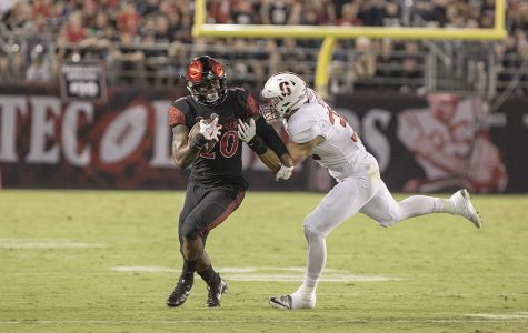 Senior running back Rashaad Penny powers through a tackle during SDSU's 20-17 win over Stanford.