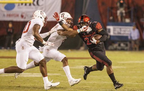 Senior running back Rashaad Penny fights off two Stanford tacklers during a run during SDSU's 20-17 win over the Cardinal.