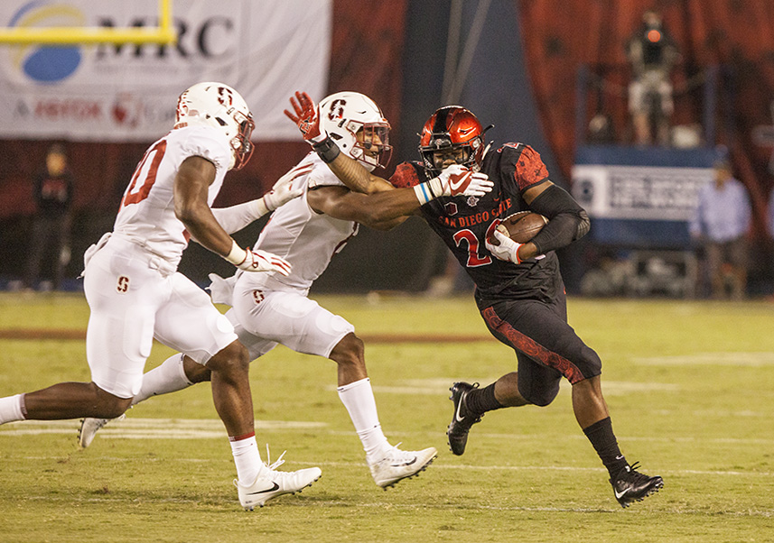 Senior+running+back+Rashaad+Penny+fights+off+two+Stanford+tacklers+during+a+run+during+SDSU%27s+20-17+win+over+the+Cardinal.