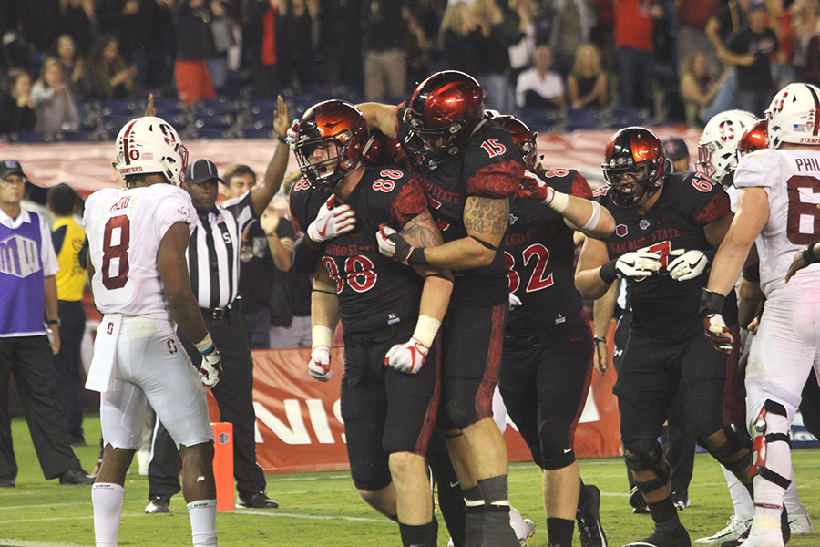 SDSU players David Wells, Nick Bawden, Antonio Rosales and Parker Houston celebrate after Wells' game-winning touchdown catch against Stanford.