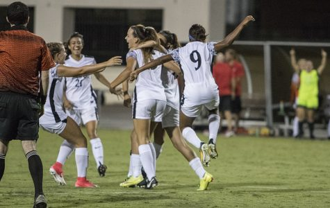 Senior midfielder Angela Mitchell celebrates with several other SDSU players after a goal over USD.