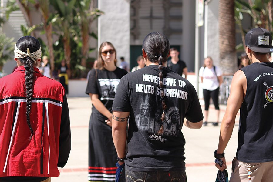 Students and sympathizers protest Columbus Day, demanding that it be changed to