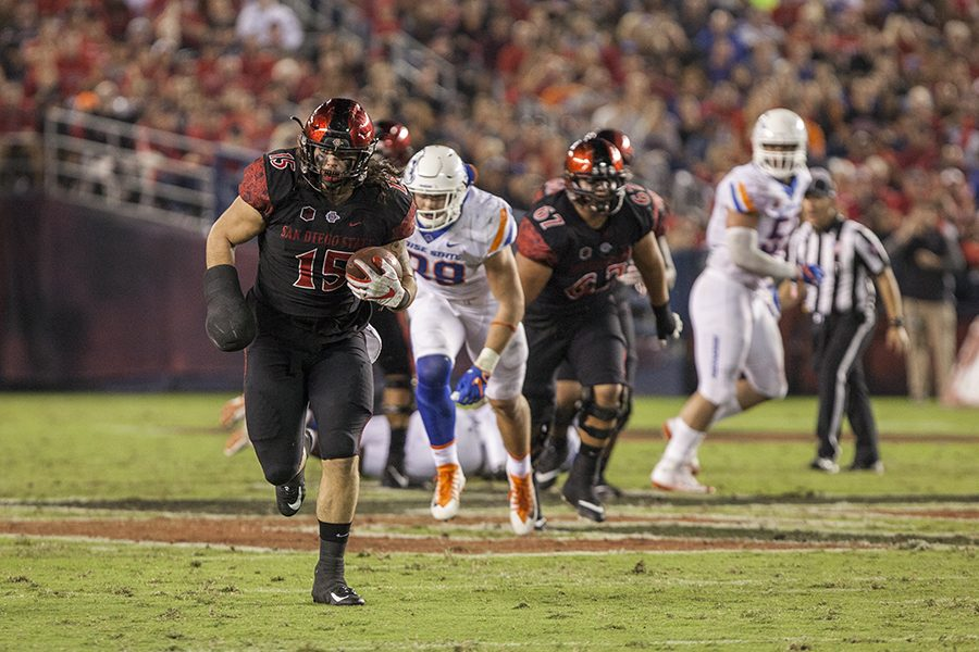 Senior fullback Nick Bawden runs with the ball during the Aztecs 31-14 loss to Boise State on Saturday, Oct. 14, at SDCCU Stadium.