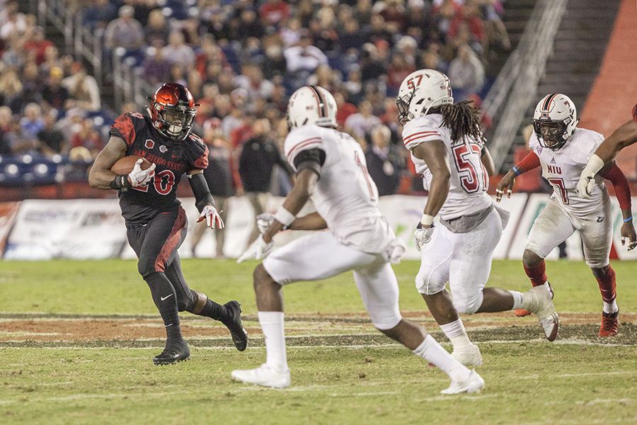 Senior+running+back+Rashaad+Penny+avoids+two+NIU+defenders+during+a+run+during+SDSU%27s+34-28+win+on+Sept.+30.