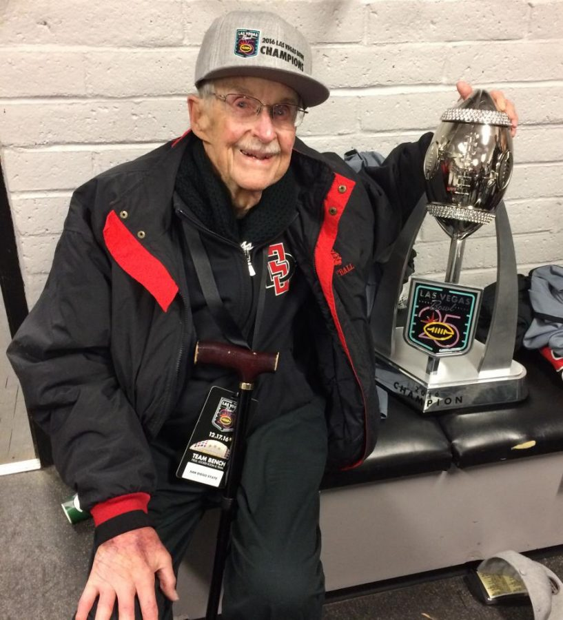 SDSU alumnus and lifetime fan Tom Ables poses with The Las Vegas Bowl Trophy.
