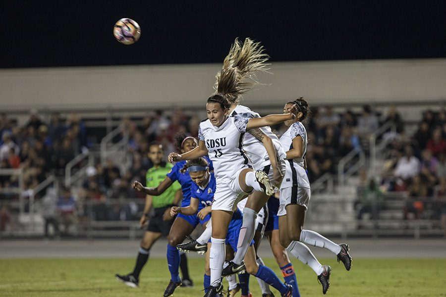 Senior forward Dani Derosa heads the ball away from the goal during SDSUs 0-0 double overtime draw with San Jose State on Friday, Oct. 6.