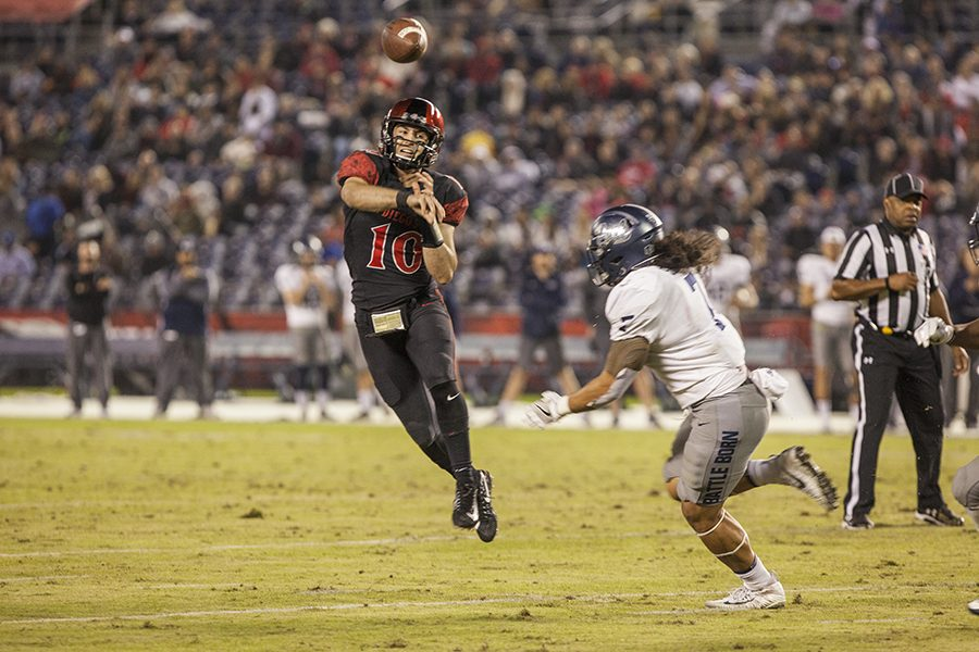 Then-junior quarterback Christian Chapman throws a pass during the Aztecs' 42-23 victory over University of Nevada last year on Nov. 18 at SDCCU Stadium.