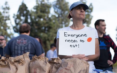 Community member Nicole Dangelo protests El Cajon's ordinance banning