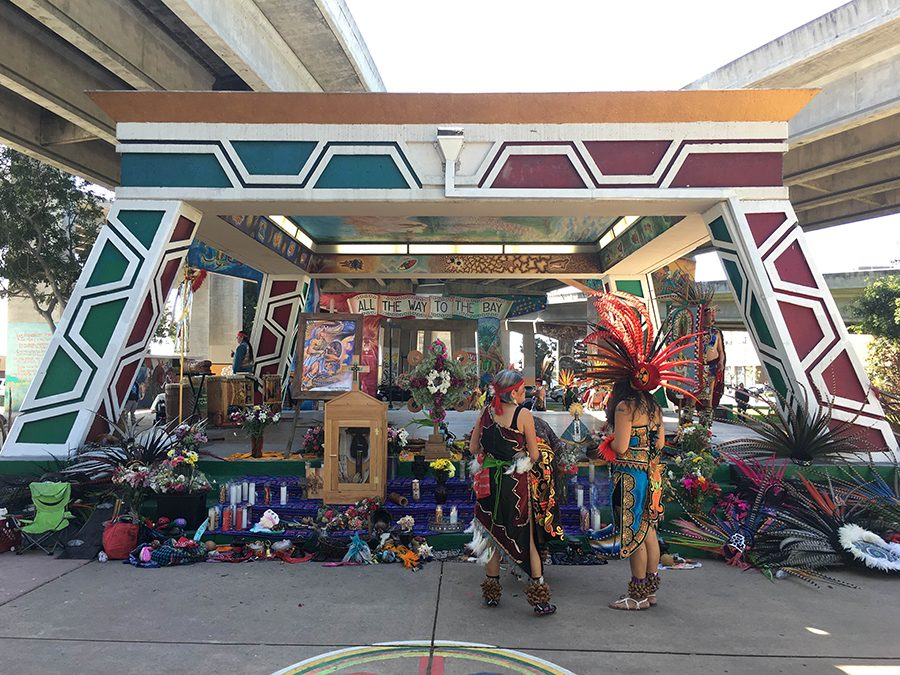 A kiosk in Chicano Park, Barrio Logan after danzantes performed and left offerings.