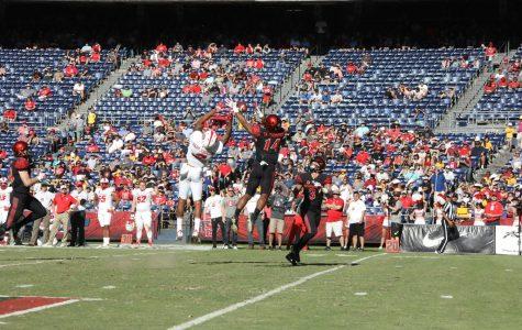 Freshman safety Tariq Thompson intercepts a pass against New Mexico on Nov. 24.