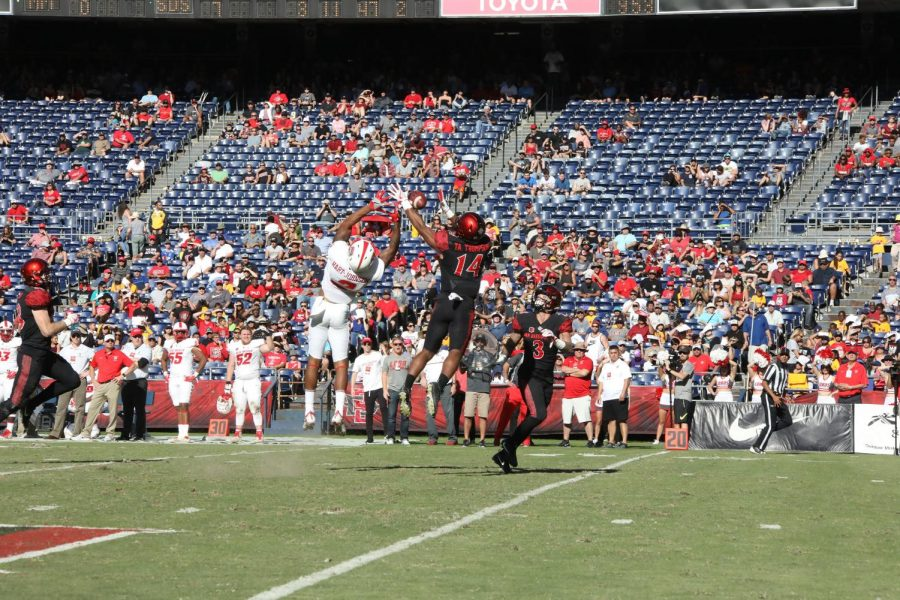 Freshman safety Tariq Thompson intercepts a pass against New Mexico on Nov. 24.