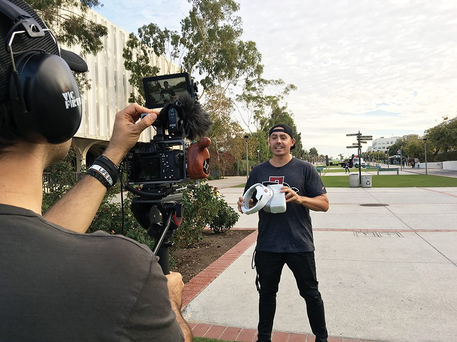 Alex Kavanagh, founder of DRONEGEAR, appears on camera for a video for his YouTube channel.