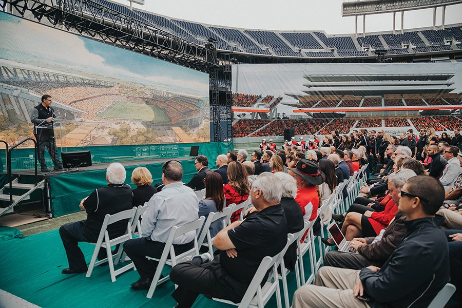 Scott Radecic, founder and senior principal at Populous, presents images of SDSU's stadium proposal in a media event at SDCCU Stadium — the intended site of the proposal.