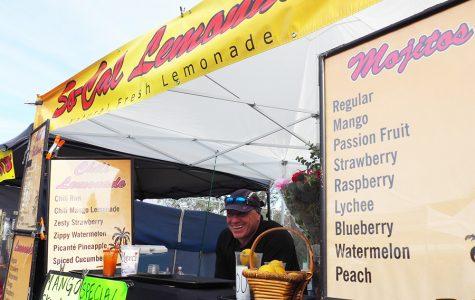 Monsieur Jean-Michel smiles at his lemonade stand at the La Jolla farmer's market Dec. 10.