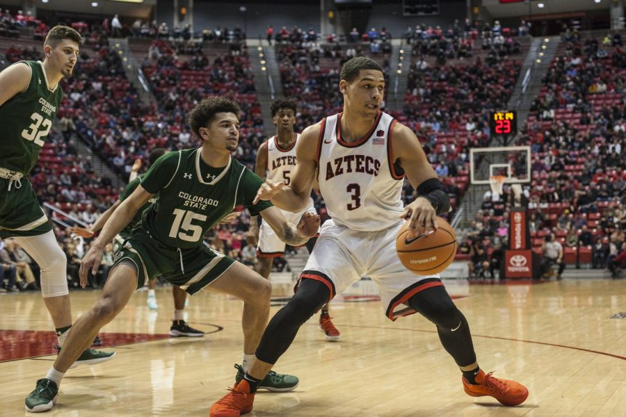 Senior guard Trey Kell (3) dribbles the ball against Colorado State redshirt sophomore guard Anthony Bonner during the Aztecs 97-78 victory over the Rams at Viejas Arena on Jan. 24