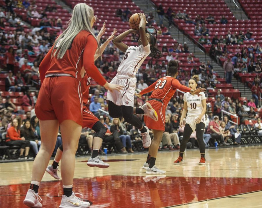 Senior guard Geena Gomez attempts a shot in the first half during the Aztecs 75-64 loss to University of Nevada, Las Vegas, at Viejas Arena on Jan. 27