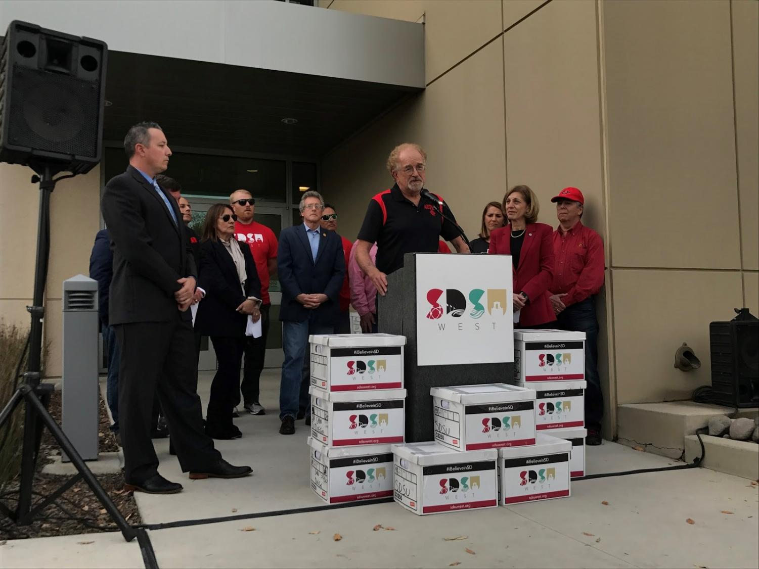 Friends of SDSU steering committee member Bill Hammit speaking at a signature turn-in event at the San Diego County Registrar of Voters office on Tuesday, Jan. 16.