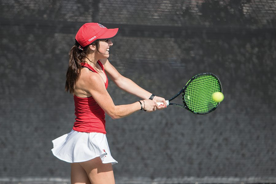 Freshman tennis player Abbie Mulbarger returns a shot during the Aztecs 5-2 home victory over UCSD on Jan.27