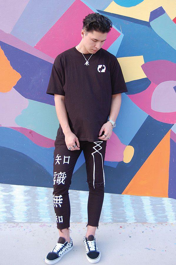 Marketing senior Noah Chen models his own fashion line Koi Clothing.