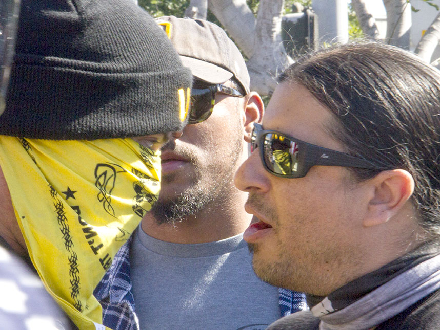 Two protesters confront one another at Chicano Park on Saturday.