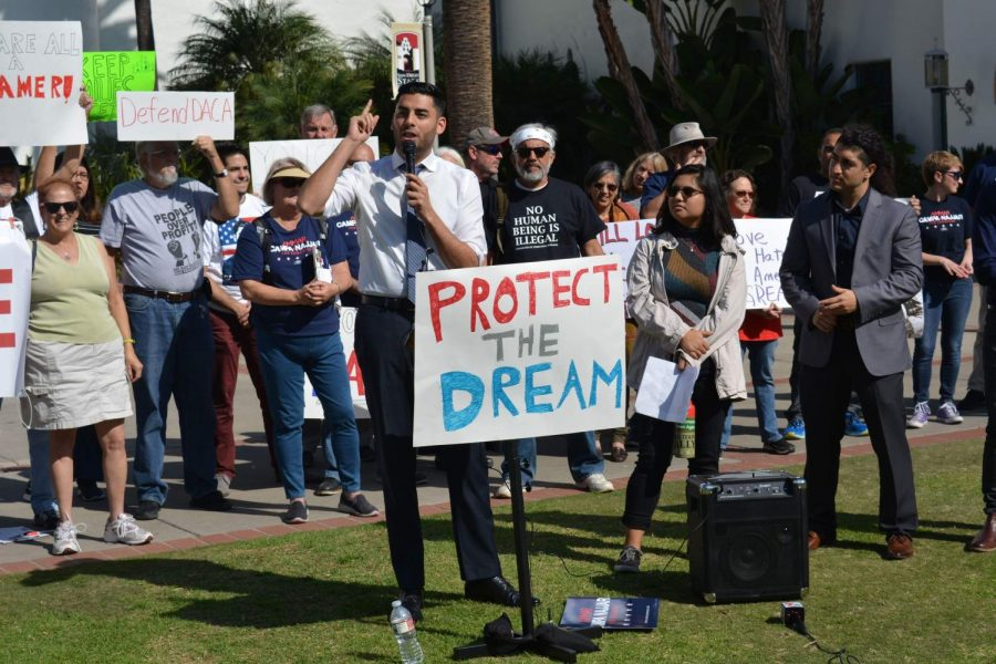 Congressional candidate Ammar Campa-Najjar addresses a crowd at a rally for immigrant rights Friday in front of Hepner Hall.