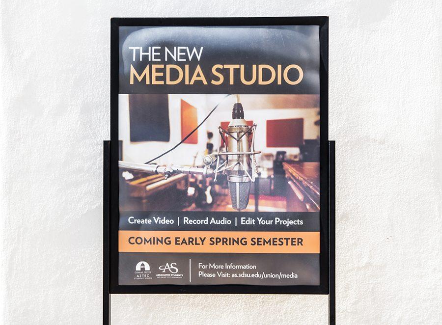 A sign advertising SDSUs new media lab in the Conrad Prebys Aztec Student Union.