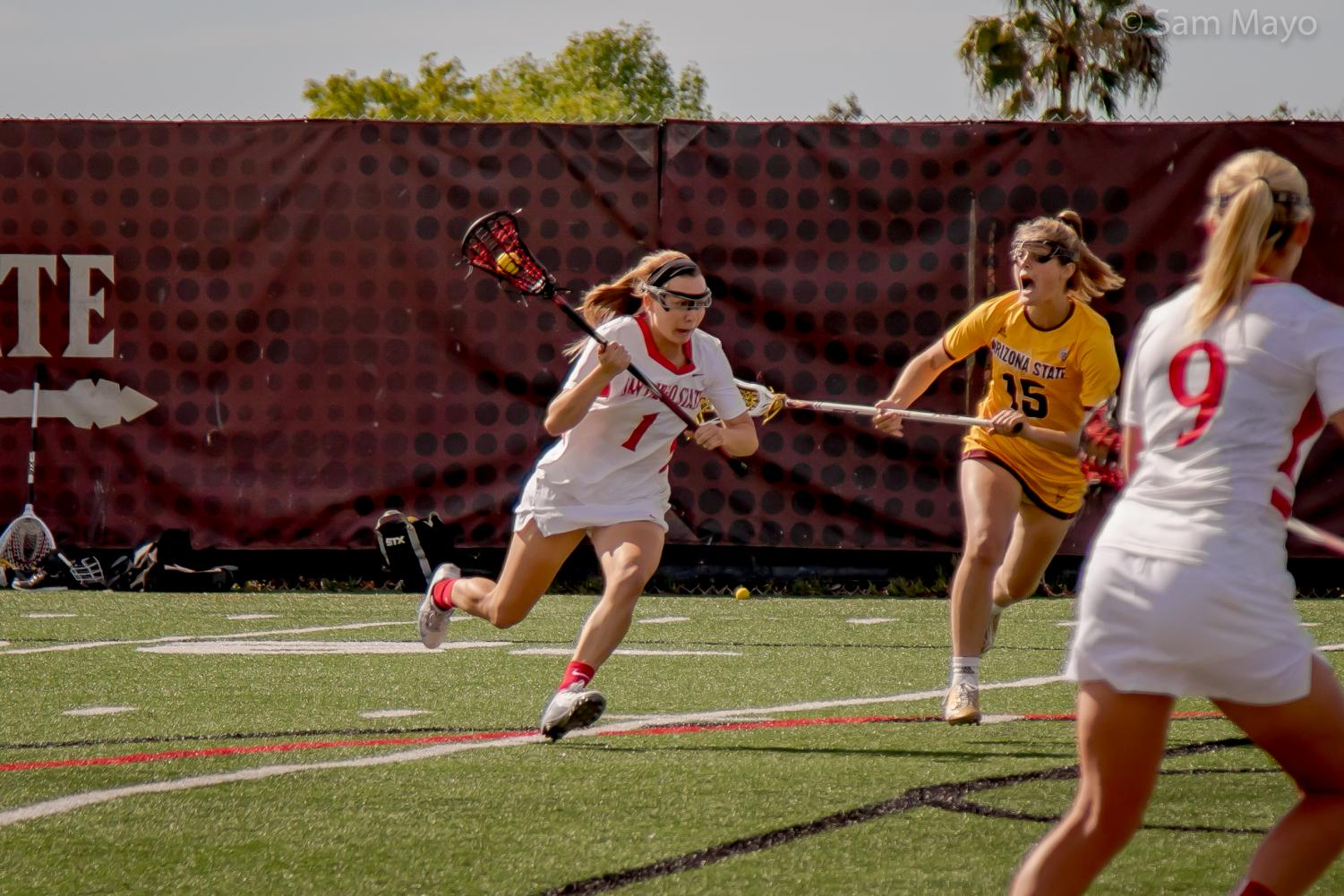Natalie Peel drives the ball up field during the Aztecs 14-13 victory over Arizona State on Feb. 17 at the Aztec Lacrosse Field.