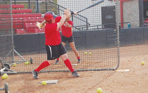 Junior Molly Sturdivant takes batting practice during practice on Jan. 30