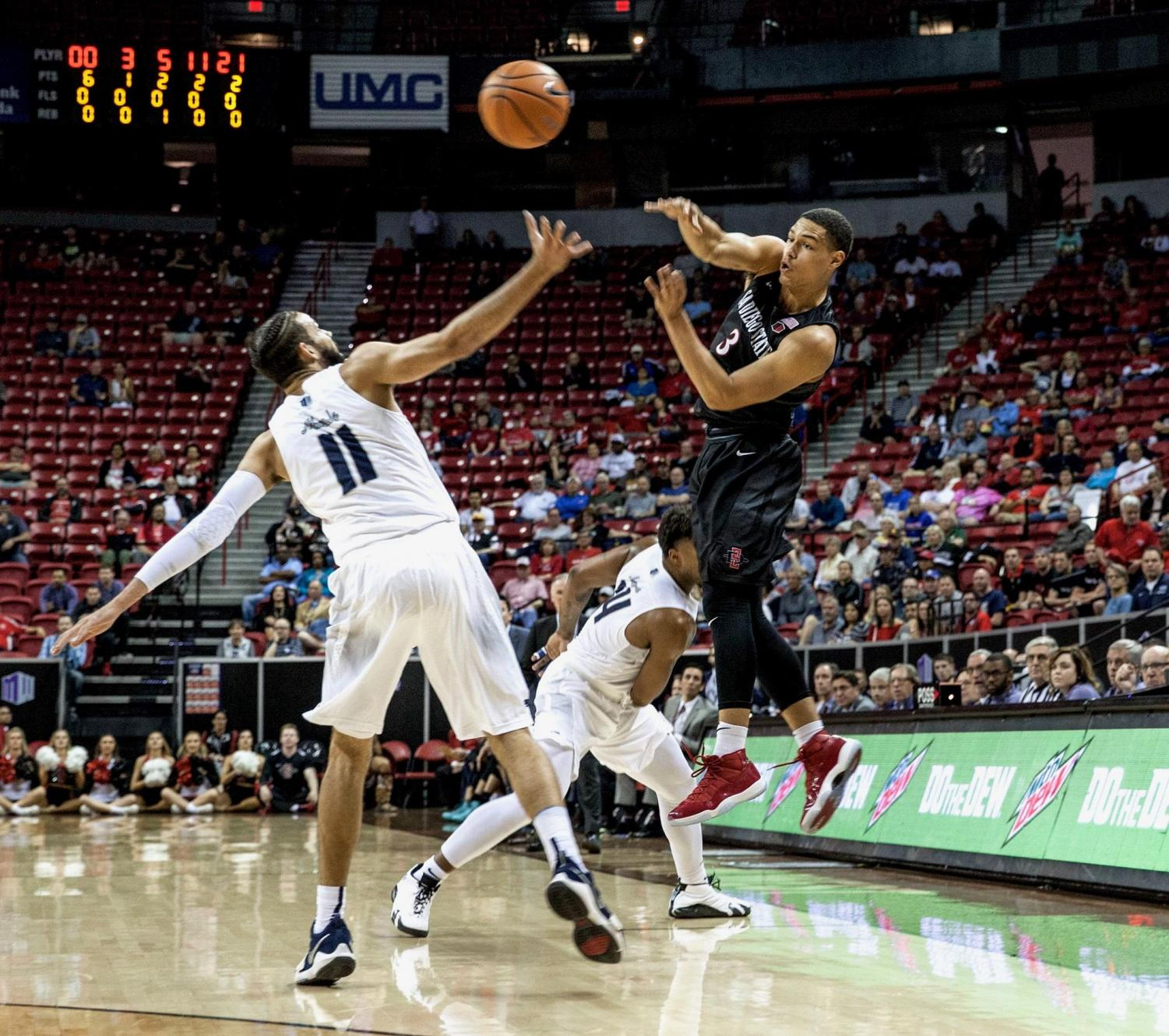 Trey Kell throws a pass during the Aztecs 90-73 victory over Nevada on March 9 at the Thomas & Mack Center in Las Vegas.