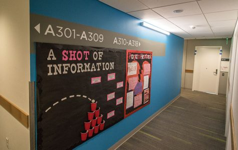 Floor three in Zura Hall displays creative information boards.