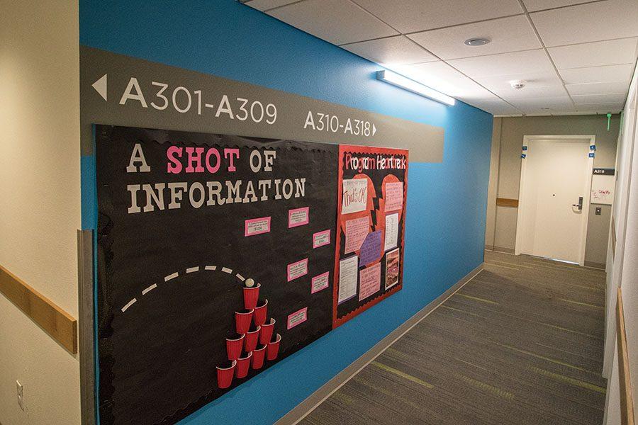 Floor three in Zura Hall displays creative information boards.