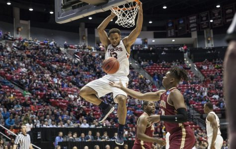 Desean Murray finishes off a dunk during Auburn's 62-58 victory over Charleston on March 16 at Viejas Arena.