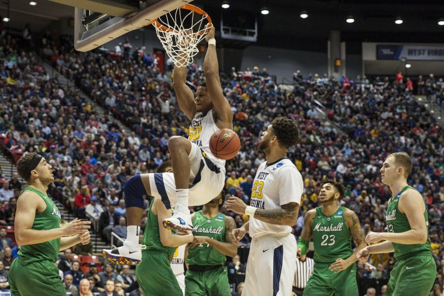 Junior forward Sagaba Konate dunks the ball during the Mountaineers 94-71 victory over Marshall on March 18 at Viejas Arena.