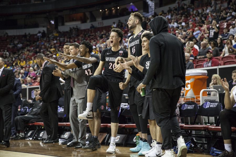 The+Aztecs+bench+celebrates+during+the+teams+64-52+victory+over+Fresno+State+in+the+quarterfinals+of+the+Mountain+West+tournament+on+March+8+in+Las+Vegas.+