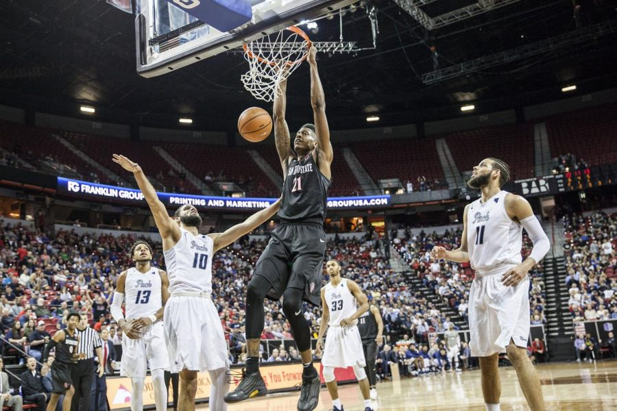 Malik Pope dunks the ball during the Aztecs 90-73 victory over Nevada on March 9 at the Thomas & Mack Center.