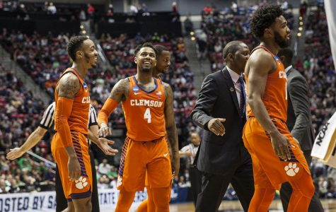 Redshirt junior guard Shelton Mitchell smiles with his teammates during Clemson's 84-59 victory over Auburn on March 18 at Viejas Arena.
