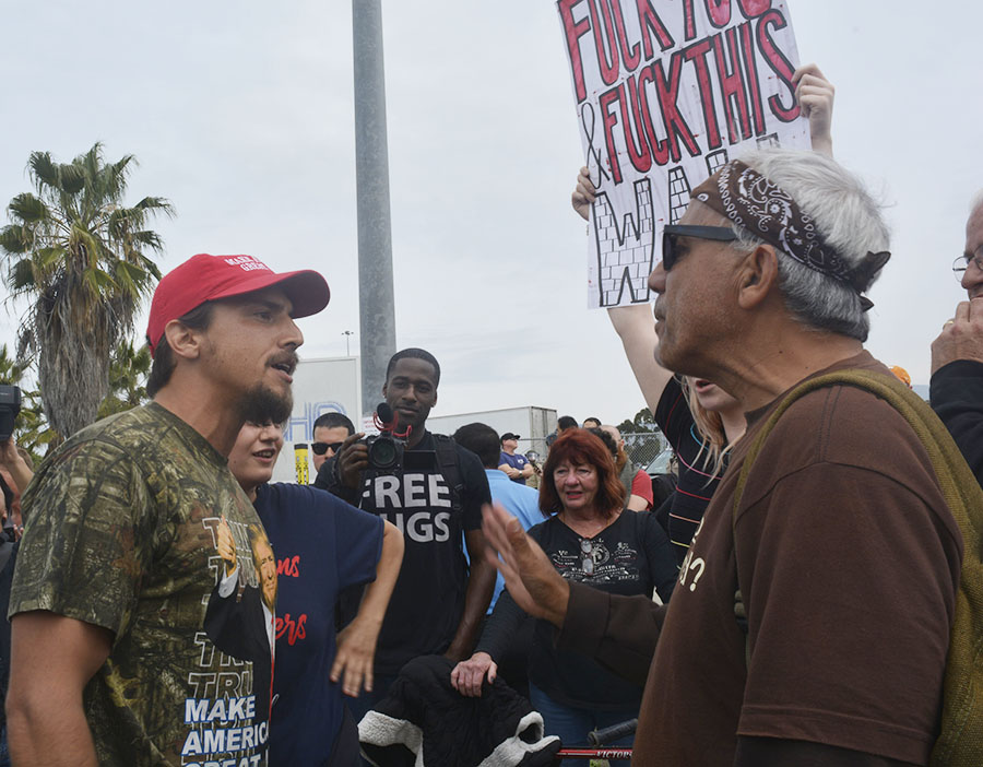 Two protesters argue during President Donald Trump's visit to Otay Mesa on Tuesday.