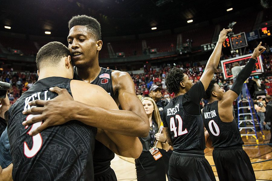 Malik Pope and Trey Kell embrace after the Aztecs won the Mountain West Conference tournament championship, 82-75, over New Mexico on March 10 at the Thomas & Mack Center in Las Vegas.