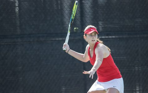 Junior Jenny Moinard competes during the Aztecs 5-2 loss to UCSD on Jan. 27 at the Aztec Tennis Center