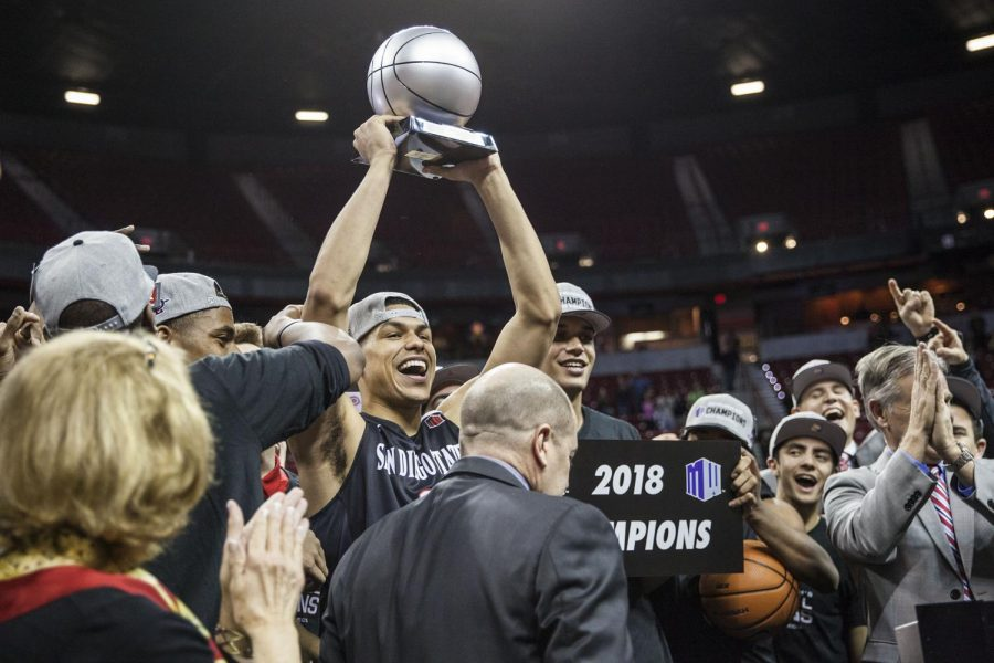 Trey Kell holds up the Mountain West Tournament MVP trophy after the Aztecs defeated New Mexico 82-75 at the Thomas & Mack Center on March 10.