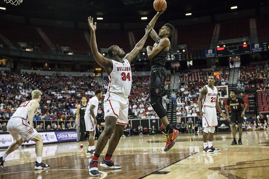 Senior forward Malik Pope shoots over senior center Terrell Carter II during the Aztecs 64-52 victory over Fresno State in the MW tournament quarterfinals on March 8 in Las Vegas.